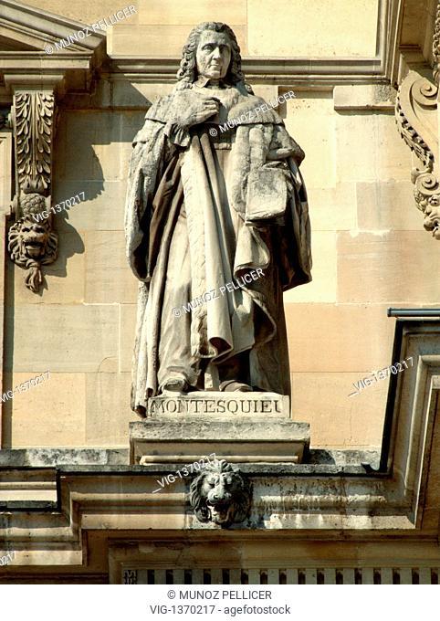 FRANCE, PARIS, 01.05.2007, Statue of french political philosopher Charles-Louis de Secondat, baron de La Brede et de MONTESQUIEU at the facade of The Louvre...