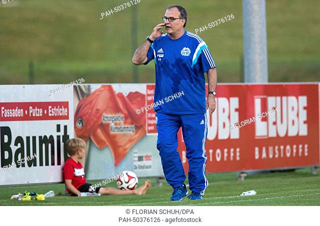Marseille's coach Marco Bielsa walks across the field during the soccer test match between Bayer 04 Leverkusen and Olympique Marseille in Seekirchen, Austria