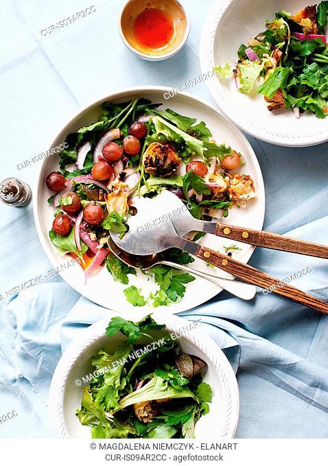 Bowls of mixed salad and dipping sauce