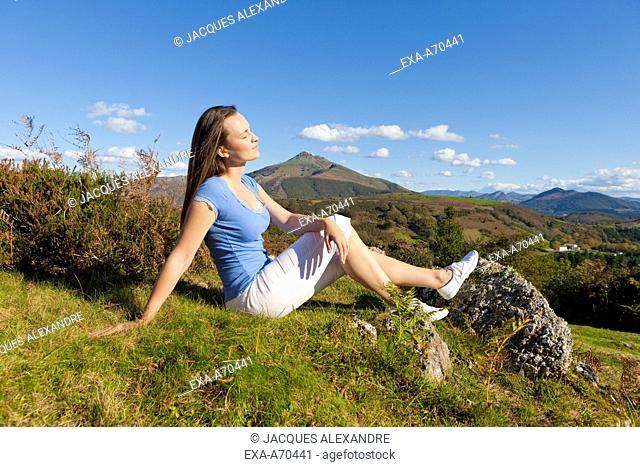 Woman enjoys mountain landscape
