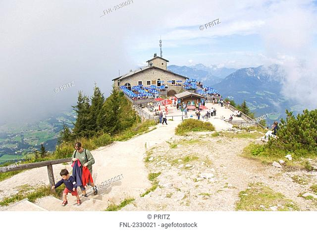 High angle view of woman walking upstairs with her son, Kehlsteinhaus, Adlerhorst, Hoher Goell, Tennengau, Obersalzberg, Berchtesgaden Alps, Bavaria, Germany