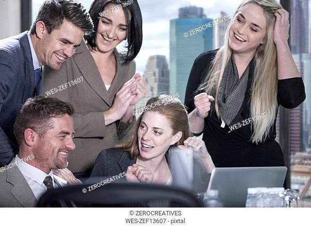 Group of happy with laptop in boardroom