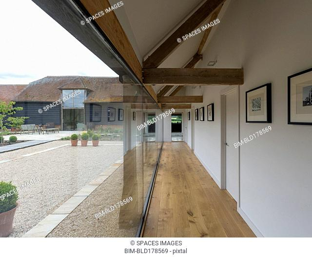 Glass wall and hallway of modern home