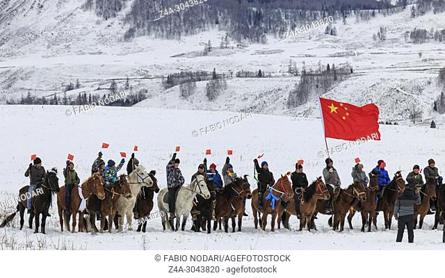 Tuva men competing in a horse racing competition in the Altai mountains in China