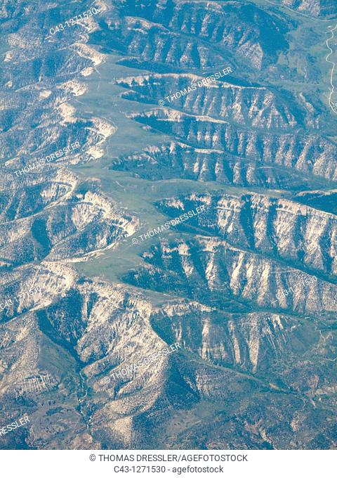 USA - Aerial view from a commercial airplane of fissured ridges at the Rocky Mountains foothills  Colorado, USA
