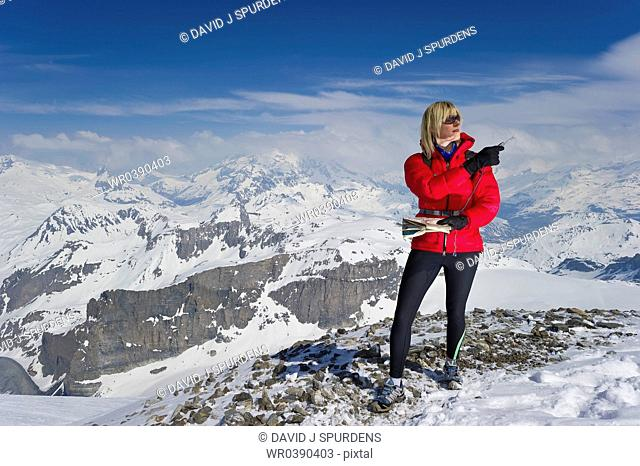 A women orienteering in high altitude mountains