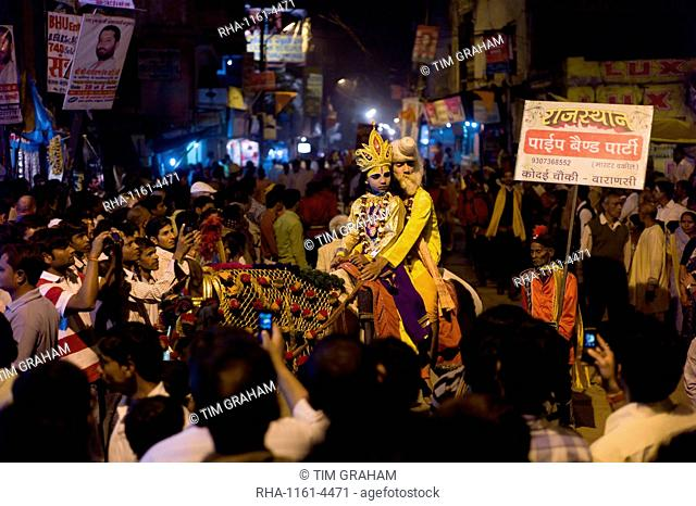 Lord Shiva and Parwati characters ride through crowd at Festival of Shivaratri in the holy city of Varanasi, Benares, Northern India