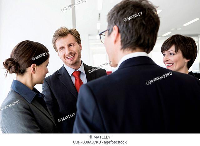 Four businesspeople having conversation