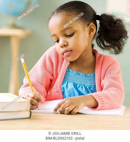 Mixed race girl doing school work