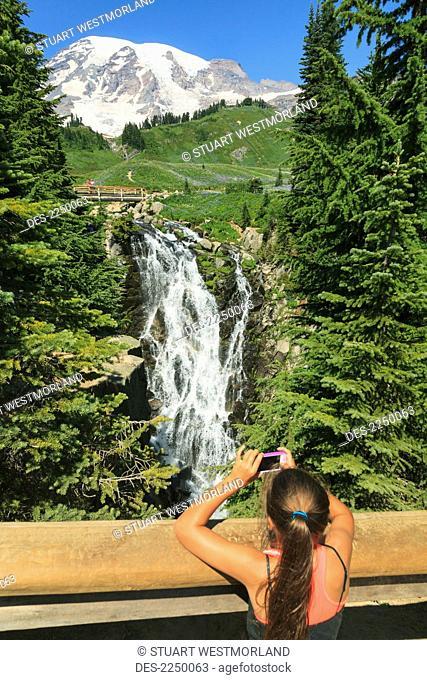 Girl Taking Photo On Smart Phone Paradise Trail Near Mount Rainier Lodge Mount Rainier National Park, Washington United States Of America