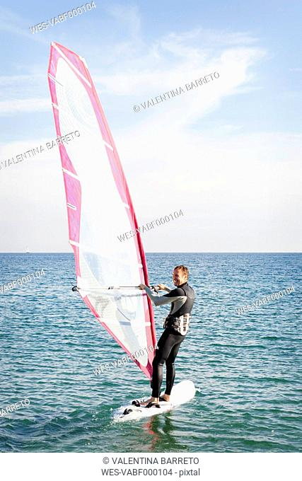 Man windsurfing on the sea