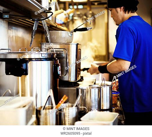 The ramen noodle shop. A chef working in a kitchen