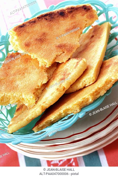 Basket of algerian bread broken into pieces, close-up