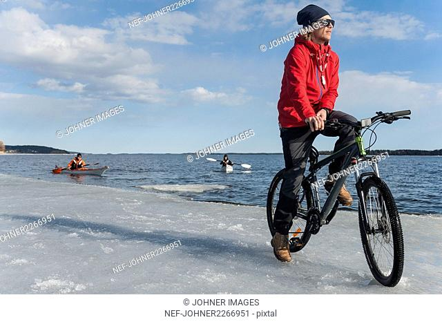 People kayaking and cycling