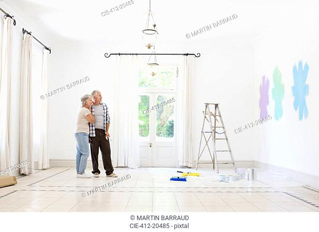 Older couple looking at paint swatches together