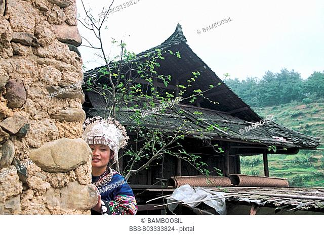 Miao minority woman wear the national clothing, Xijiang Miao Village, Kaili City, Guizhou Province of People's Republic of China