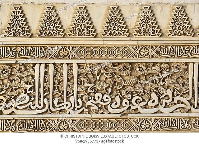 Spain, Andalusia, Granada, World Heritage Site, The Alhambra, Nasrid palaces, Elaborately decorated plaster wall enhanced with islamic calligraphy