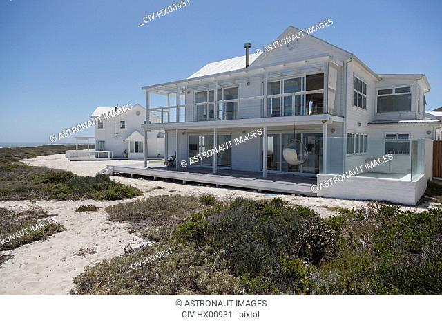 White beach house under sunny blue sky