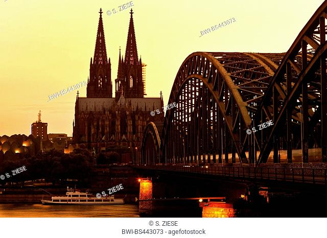 silhouette of the Cologne Cathedral with Hohenzollern Bridge at the sunset , Germany, North Rhine-Westphalia, Cologne