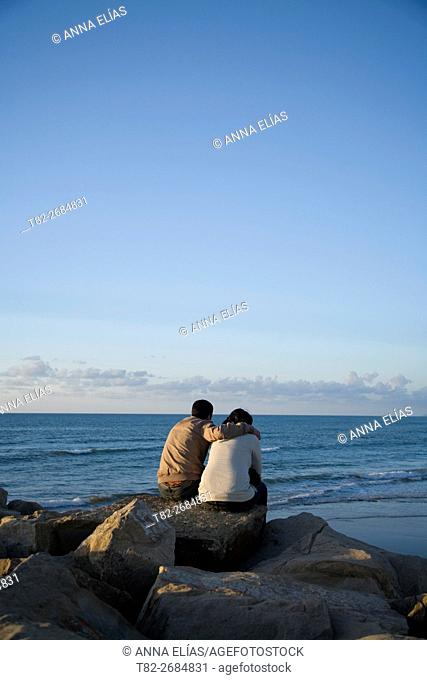 couple in love looking at the sea, Tangier, Marocco