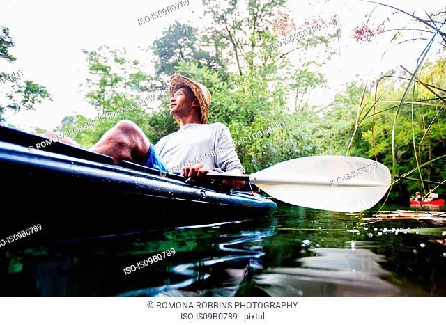 Man kayaking at Econfina Creek, Florida, USA