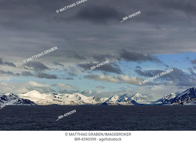 Coastline, snowy mountains, Northwest Coast, Svalbard, Spitsbergen, Norway