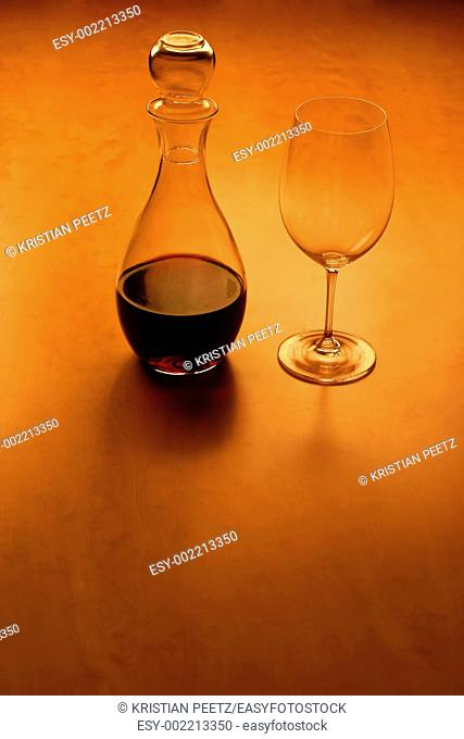 Front view of a glas and wine on a wooden table, very warm feeling with copy-space