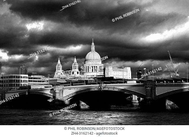 London, England, UK. St Paul's Cathedral, River Thames and Blackfriars Bridge on a dramatic cloudy day in December