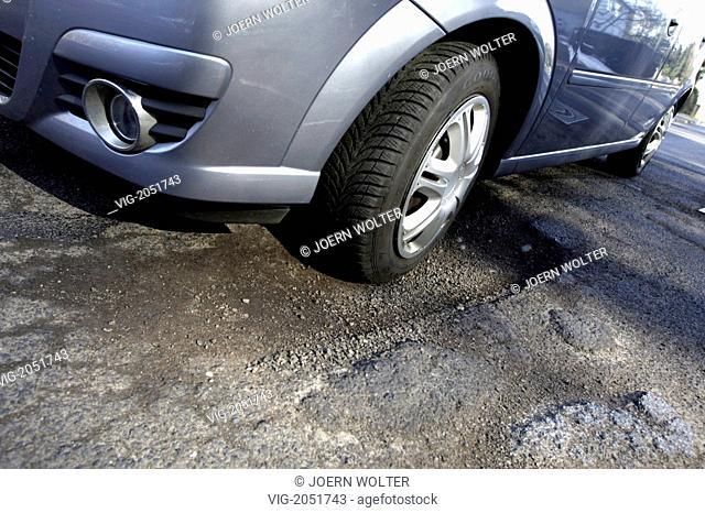 GERMANY, BONN, 09.03.2010, Road hole in the street, roadway damage. - BONN, GERMANY, 09/03/2010