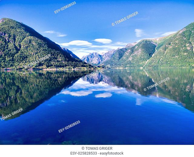Scenic view of picturesque norwegian fjord surrounded by mountains