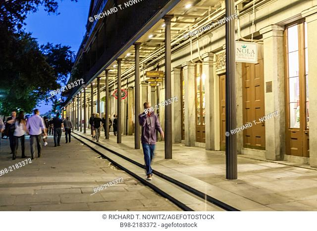 Night street scenes in the Fench Quarter of New Orleans, Louisiana, USA