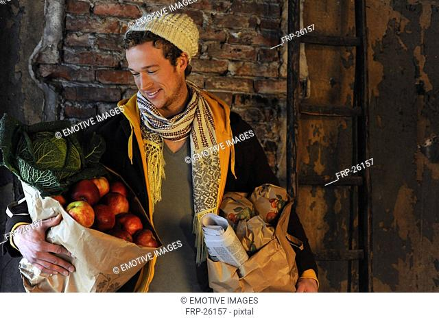 Man carrying shopping bags with produce