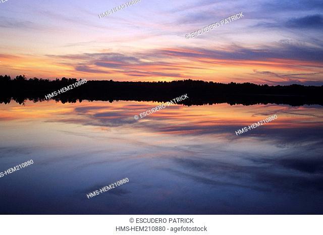 France, Loir et Cher, Sologne, La Ferte Beauharnais, sunset over a pond