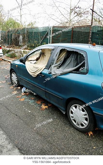 vandalised car used as a shelter by the homeless