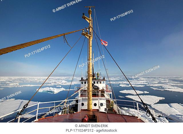 Ship among drift ice / ice floes in the Arctic Ocean, Nordaustlandet / North East Land, Svalbard / Spitsbergen, Norway