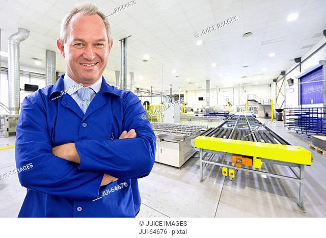 Portrait of Supervisor worker smiling at camera on solar panel factory floor production line
