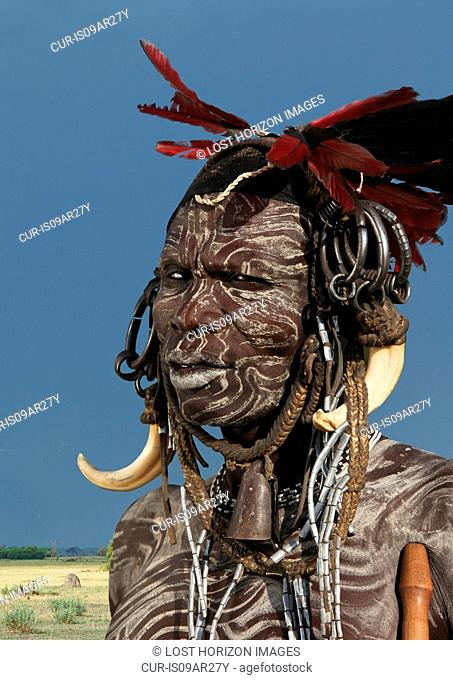 Portrait of man from Mursi tribe decorated with face paint, Ethiopia, Africa
