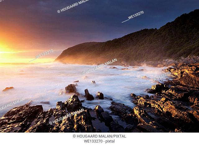 Landscape photo of a colourful sunset on the Tsitsikamma coastline. Tsitsikamma National Park, Western Cape, South Africa