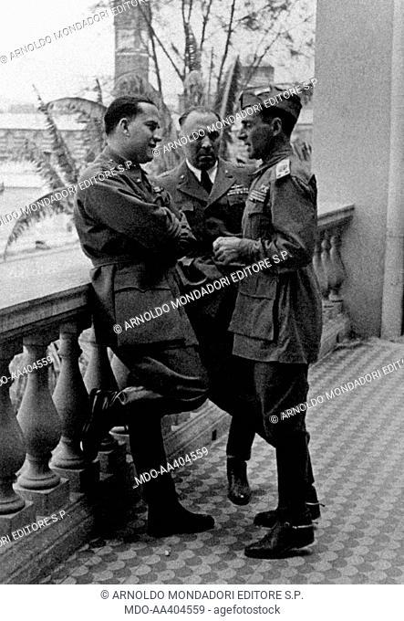 Galeazzo Ciano, Achille Starace e Roberto Farinacci talking. Italian diplomat and politician Galeazzo Ciano (Gian Galeazzo Ciano) talking with Italian...