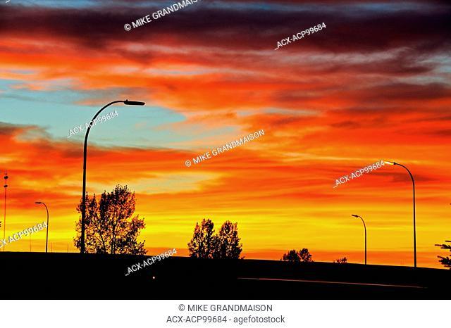 Blazing sky at sunrise on Trans Canada Highway Swift Current Saskatchewan Canada