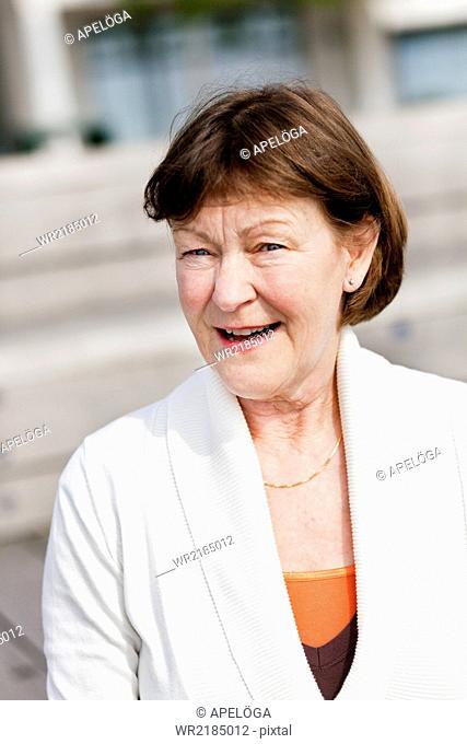 Portrait of happy senior woman outdoors