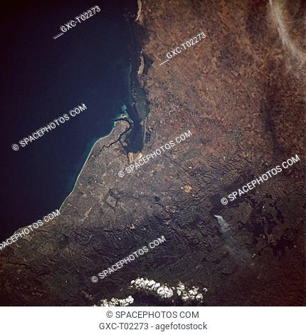 Visible in this northeast-looking, low-oblique photograph is Adelaide—the capital and chief port of the state of South Australia and the first municipality in...