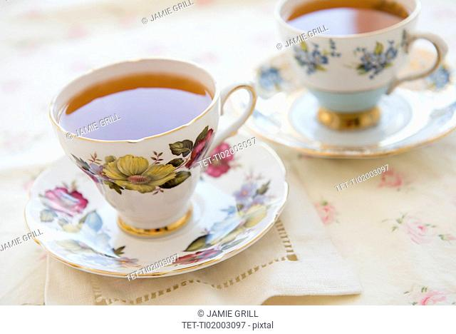 Tea in tea cup on table