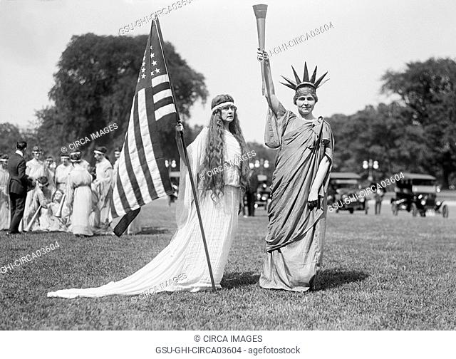 Woman with American Flag and Women in Statue of Liberty Costume, Fourth of July Celebration, the Ellipse, Washington DC, USA, Harris & Ewing, 1919
