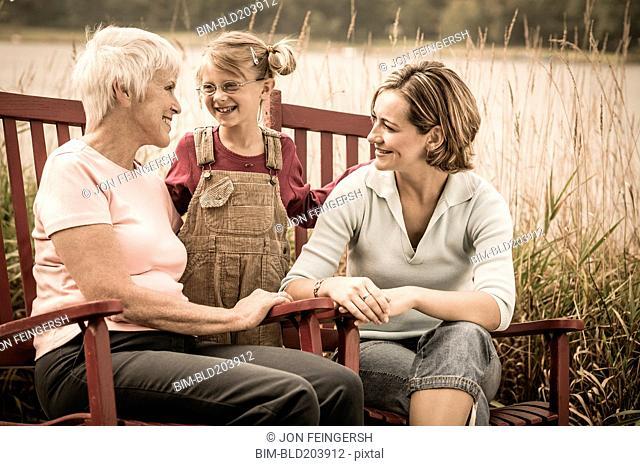 Three generations of Caucasian women smiling