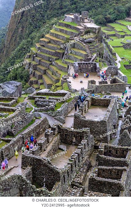 Peru, Machu Picchu. Looking down on the Western Urban Sector, with the Intiwatana (Hitching Post of the Sun) and Agricultural Terraces in the Upper Half
