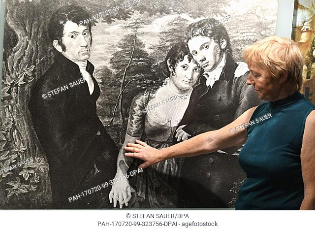 The head of the museum Barbara Roggow can be seen pointing at a photograph at the Runge House in Wolgast, Germany, 19 July 2017