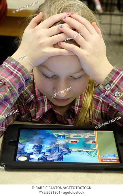 Preteen Girl Using iPad to Learn Coding for School Assignment, Wellsville, New York, USA