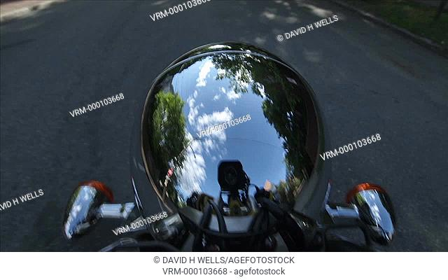 Time-lapse animation of reflections in a chrome covered motorcycle head light casing in Providence, Rhode Island, United States
