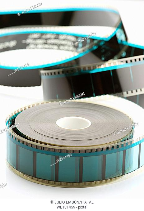 35mm film reel on white base loose